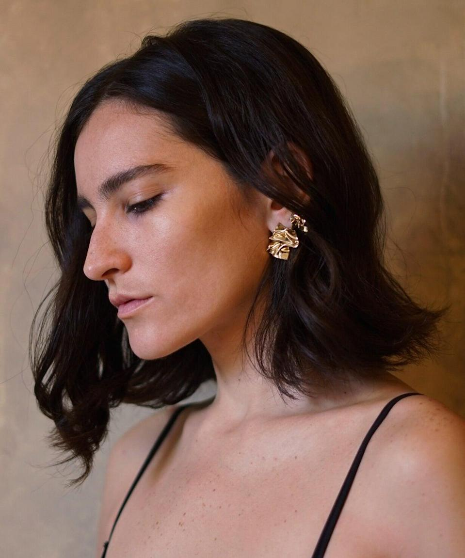 """<strong><h2>Nina Rios</h2></strong>Puerto Rican jewelry designer Nina Rios is trained in metal smithing, creating accessories with a vintage finish. Launched in 2016, her New York City-based brand is focused on communicating the designer's experiences living in New York's urban landscape and the lush Caribbean island she grew up in. <br><br><em>Shop <a href=""""https://www.ninariosbk.com/"""" rel=""""nofollow noopener"""" target=""""_blank"""" data-ylk=""""slk:Nina Rios"""" class=""""link rapid-noclick-resp"""">Nina Rios</a></em>"""
