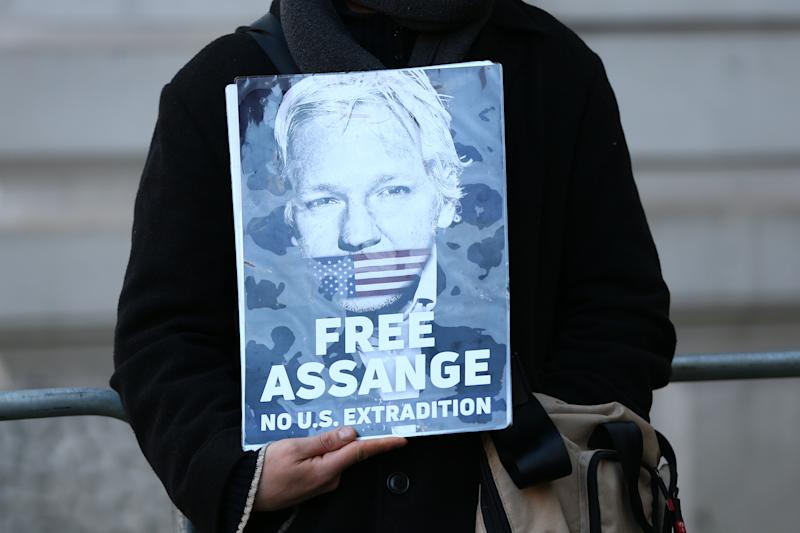 LONDON, ENGLAND - NOVEMBER 18: Julian Assange supporters demonstrate outside of the Westminster Magistrates Court on November 18, 2019 in London, England. (Photo by Hollie Adams/Getty Images)