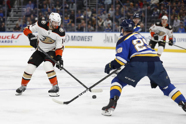 Anaheim Ducks' Adam Henrique (14) handles the puck as St. Louis Blues' Vince Dunn (29) defends during the first period of an NHL hockey game Monday, Jan. 13, 2020, in St. Louis. (AP Photo/Jeff Roberson)