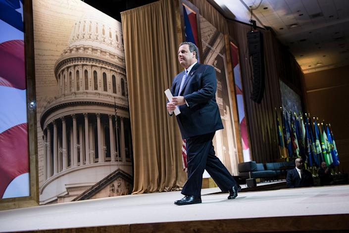 New Jersey Governor Chris Christie leaves the podium after addressing the American Conservative Union Conference(CPAC) March 6, 2014 at National Harbor, Maryland. The conference is the largest annual gathering of conservative leaders and activists, and when there's no Republican in the White House, it's a must-attend cattle call for GOP presidential hopefuls looking to pass the conference's conservative litmus test. (Photo credit should read BRENDAN SMIALOWSKI/AFP/Getty Images)