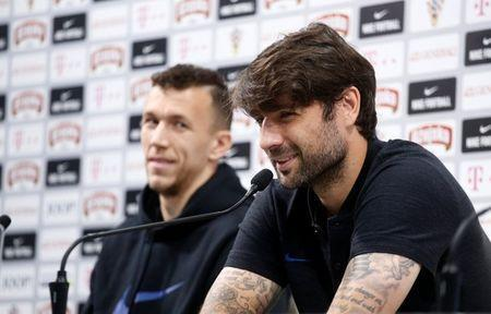 Soccer Football - World Cup - Croatia Press Conference - Croatia Training Camp, Roschino, Russia - June 23, 2018 Croatia's Ivan Perisic and Vedran Corluka during the press conference REUTERS/Anton Vaganov