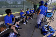 Israel Olympic baseball players take a break in the dugout during practice at Salt River Fields spring training facility, Wednesday, May 12, 2021, in Scottsdale, Ariz. Israel has qualified for the six-team baseball tournament at the Tokyo Olympic games which will be its first appearance at the Olympics in any team sport since 1976. (AP Photo/Matt York)