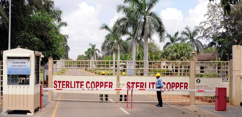 FILE PHOTO - A private security guard stands in front of the main gate of Sterlite Industries Ltd's copper plant in Tuticorin