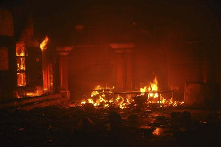 A Hindu temple burns after it was attacked in Larkana, southern Pakistan's Sindh province, March 15, 2014. REUTERS/Faheem Soormro
