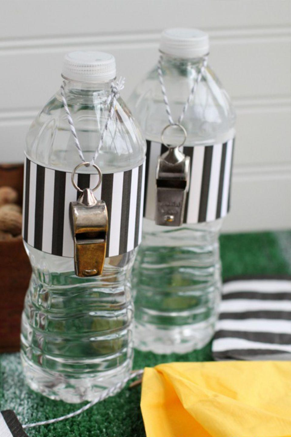 "<p>Even water gets to dress up for the Super Bowl, thanks to these cute labels.<br></p><p><em><a href=""http://www.threelittlemonkeysstudio.com/10-free-football-printables-get-together/"" rel=""nofollow noopener"" target=""_blank"" data-ylk=""slk:Get the printables at Three Little Monkeys Studio »"" class=""link rapid-noclick-resp"">Get the printables at Three Little Monkeys Studio »</a></em> </p><p><a class=""link rapid-noclick-resp"" href=""https://www.amazon.com/Hipat-Whistle-Whistles-Referees-Officials/dp/B07QWRP934/?tag=syn-yahoo-20&ascsubtag=%5Bartid%7C10055.g.4949%5Bsrc%7Cyahoo-us"" rel=""nofollow noopener"" target=""_blank"" data-ylk=""slk:SHOP WHISTLES"">SHOP WHISTLES</a></p>"