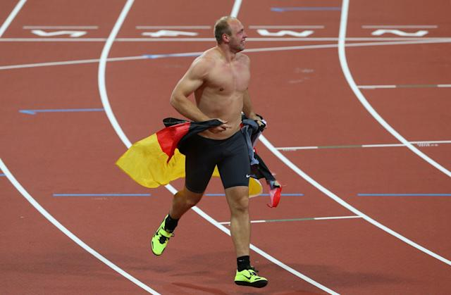 LONDON, ENGLAND - AUGUST 07: Robert Harting of Germany celebrates winning gold in the Men's Discus Throw Final on Day 11 of the London 2012 Olympic Games at Olympic Stadium on August 7, 2012 in London, England. (Photo by Cameron Spencer/Getty Images)