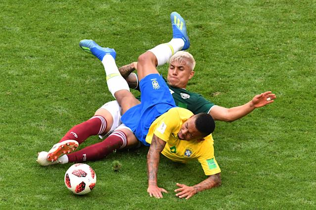 <p>Brazil's forward Gabriel Jesus (R) is tackled by Mexico's defender Carlos Salcedo during the Russia 2018 World Cup round of 16 football match between Brazil and Mexico at the Samara Arena in Samara on July 2, 2018. (Photo by SAEED KHAN / AFP) </p>