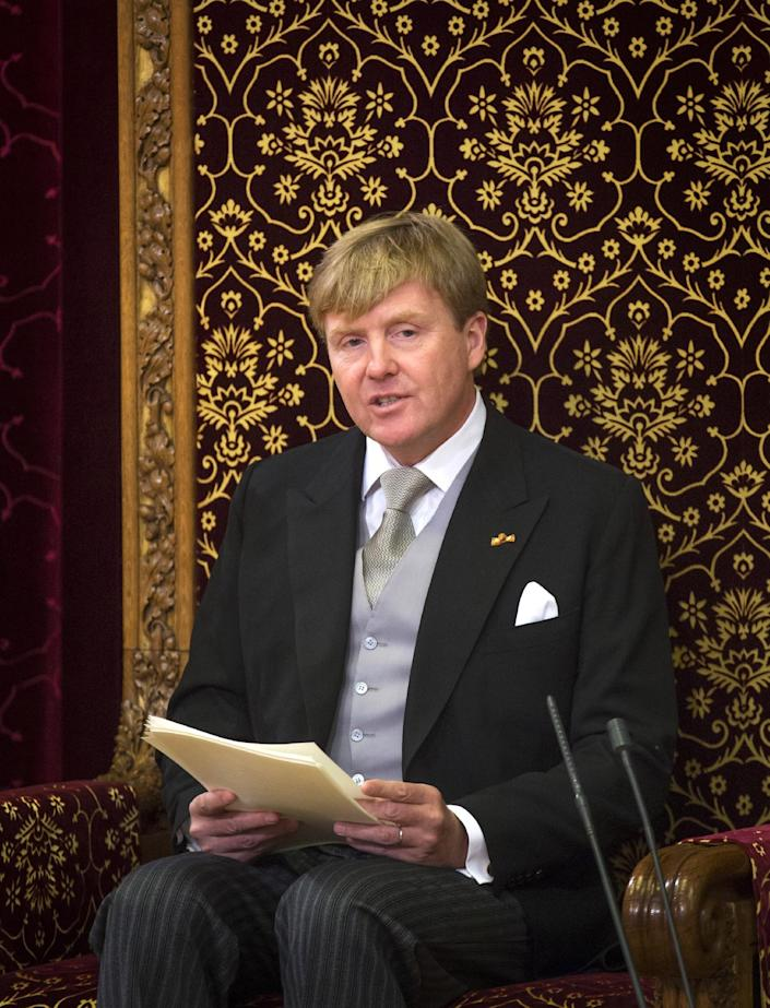 """Netherlands' King Willem-Alexander officially opens the new parliamentary year with a speech outlining the government's plan and budget policies for the year ahead, in the 13th century """"Hall of Knights"""" in The Hague, Netherlands, Tuesday, Sept. 17, 2013. (AP Photo/Frank Van Beek, Pool)"""