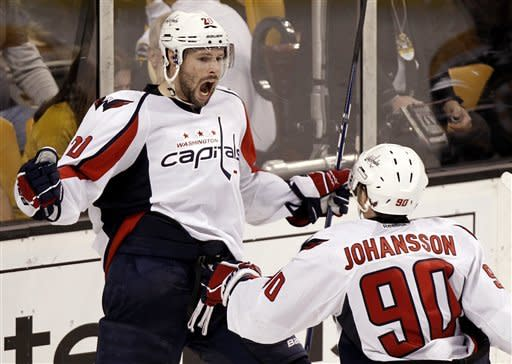 Washington Capitals' Troy Brouwer celebrates his winning goal with teammate Marcus Johansson (90) during the third period of Washington's 4-3 win over the Boston Bruins in Game 5 in a first-round NHL Stanley Cup playoff hockey series in Boston Saturday, April 21, 2012. (AP Photo/Winslow Townson)