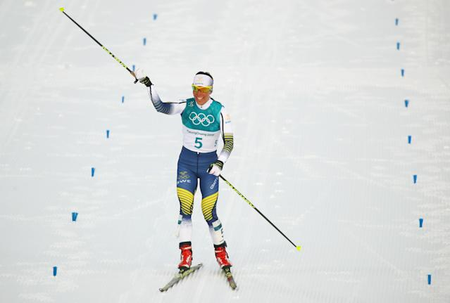 Charlotte Kalla of Sweden celebrates after winning the women's 15km skiathlon in PyeongChang, South Korea on Saturday. (Reuters)