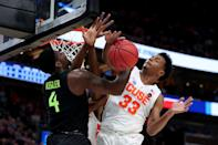 <p>Mario Kegler #4 of the Baylor Bears defends the net against Elijah Hughes #33 of the Syracuse Orange during the first half in the first round of the 2019 NCAA Men's Basketball Tournament at Vivint Smart Home Arena on March 21, 2019 in Salt Lake City, Utah. </p>
