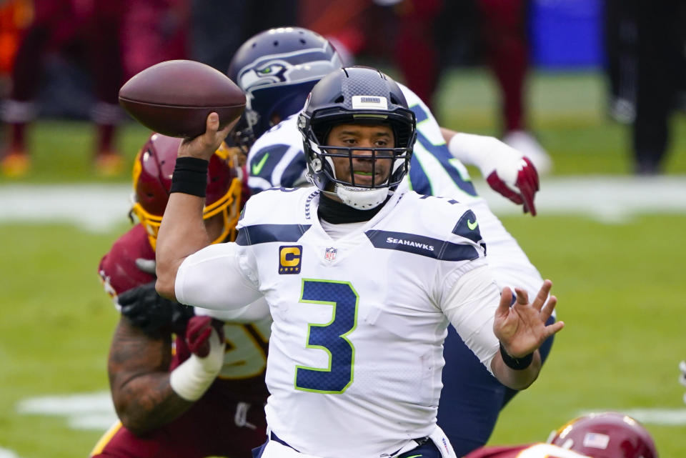 Seattle Seahawks quarterback Russell Wilson (3) passes the ball during the first half of an NFL football game against the Washington Football Team, Sunday, Dec. 20, 2020, in Landover, Md. (AP Photo/Mark Tenally)