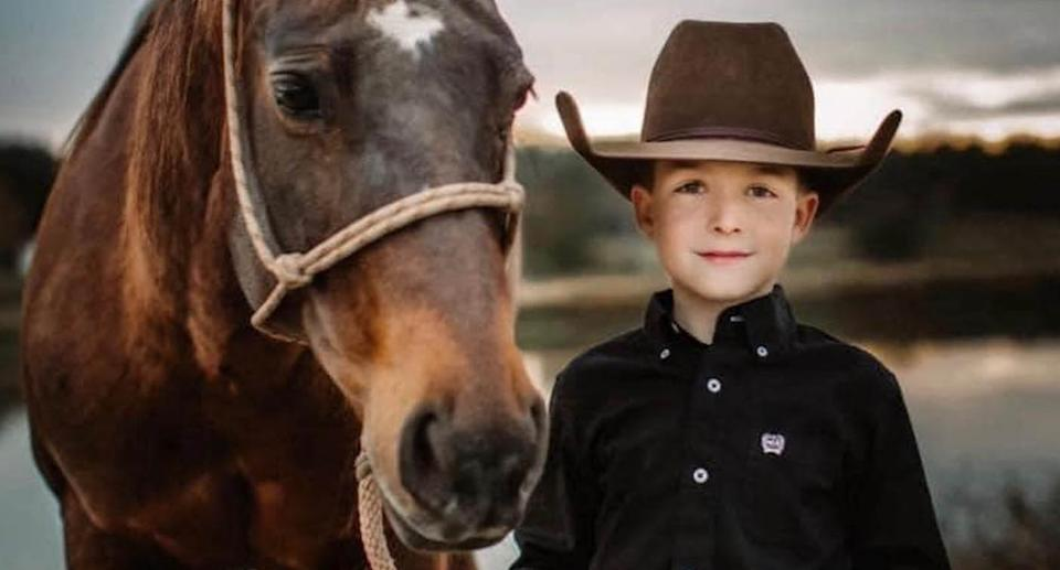 Legend Williamson, 10, is pictured with a horse.