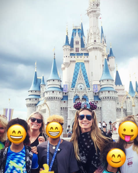 "<p>The model whisked her foursome — Helene, Lou, Johan, and Henry — to Walt Disney World for <a href=""https://www.instagram.com/p/BVfiOCNgKOL/?taken-by=heidiklum"" rel=""nofollow noopener"" target=""_blank"" data-ylk=""slk:a few days"" class=""link rapid-noclick-resp"">a few days</a> in June. She obscured her kids's faces with smiling emojis in the snapshot she shared from the trip, but the truth is that their actual faces probably didn't look much different! (Photo: Heidi Klum via Instagram) </p>"