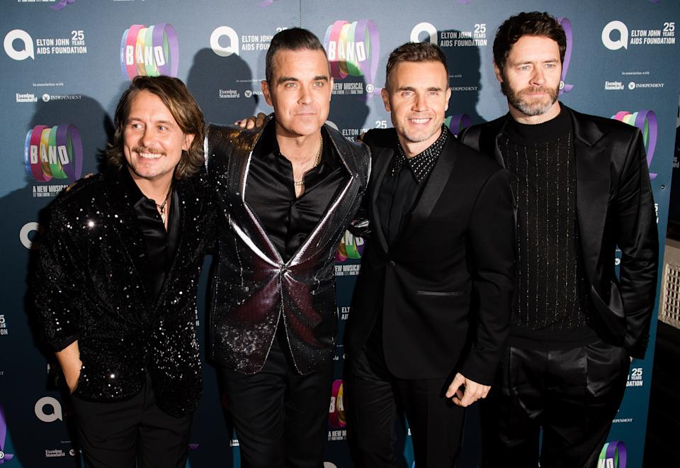 """LONDON, ENGLAND - DECEMBER 04:  Mark Owen, Robbie Williams, Gary Barlow and Howard Donald attend a charity gala performance of """"The Band"""" in aid of the Elton John AIDS Foundation at Theatre Royal Haymarket on December 04, 2018 in London, England. (Photo by Samir Hussein/WireImage)"""