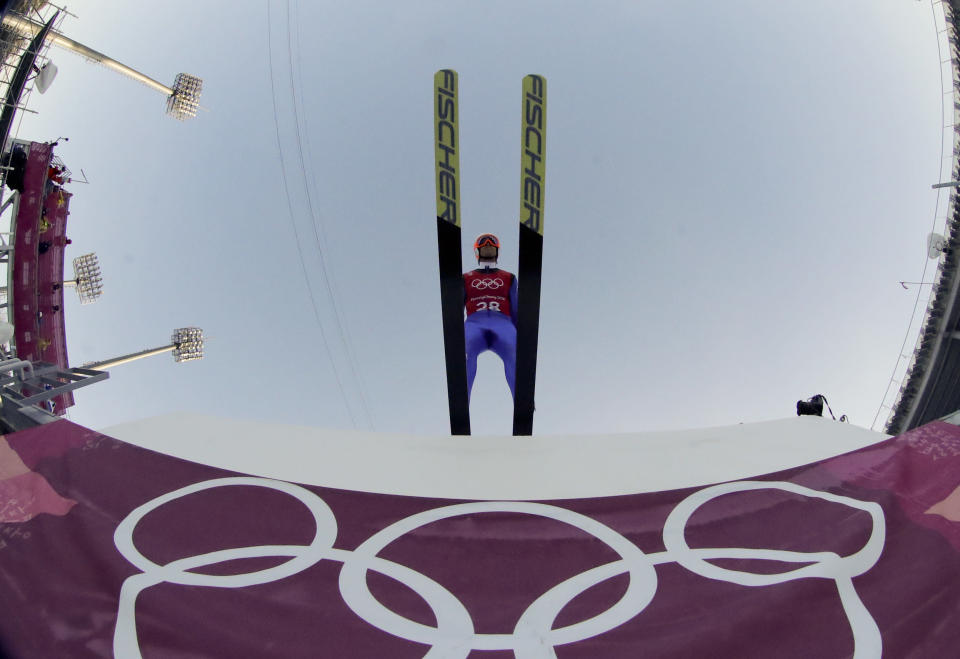 <p>Tim Hug, of Switzerland, takes off during a training jump for the men's Nordic Combined competition at the 2018 Winter Olympics in Pyeongchang, South Korea, Monday, Feb. 12, 2018. (AP Photo/Dmitri Lovetsky) </p>
