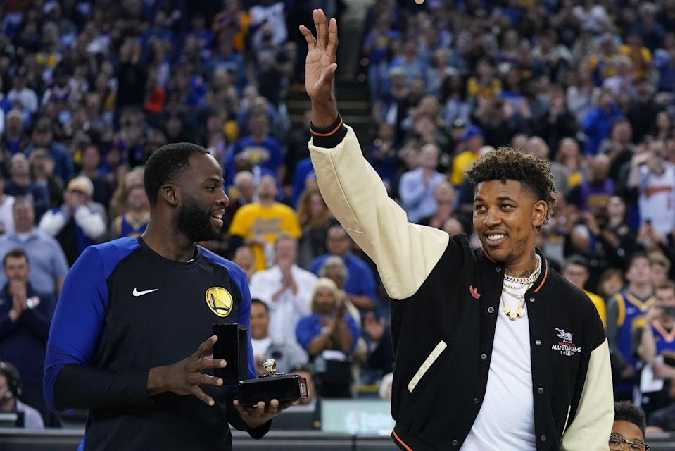 April 5, 2019; Oakland, CA, USA; Golden State Warriors former player Nick Young (right) receives his championship ring from forward Draymond Green (left) before the game against the Cleveland Cavaliers at Oracle Arena. Mandatory Credit: Kyle Terada-USA TODAY Sports