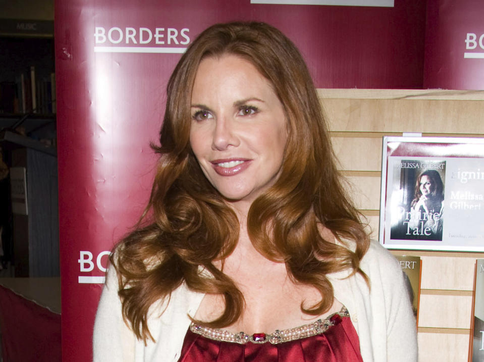 """FILE - Actress Melissa Gilbert appears at Borders Books to promote her autobiography """"Prairie Tail"""" in New York on June 9, 2009. Gilbert, who starred as Laura Ingalls on """"Little House on the Prairie,"""" is part of an upcoming PBS documentary about Laura Ingalls Wilder, whose novels inspired the TV series. (AP Photo/Charles Sykes, File)"""