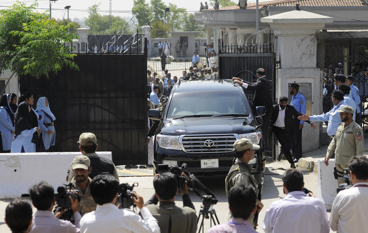 Pakistan's former President and military ruler Pervez Musharraf leaves the High Court in Islamabad, Pakistan, Thursday, April 18, 2013. Musharraf and his security team pushed past policemen and sped away from a court in the country's capital on Thursday after his bail was revoked in a case in which he is accused of treason. (AP Photo/B.K. Bangash)