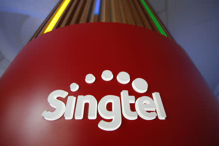 FILE PHOTO: A Singtel logo is pictured at their head office in Singapore