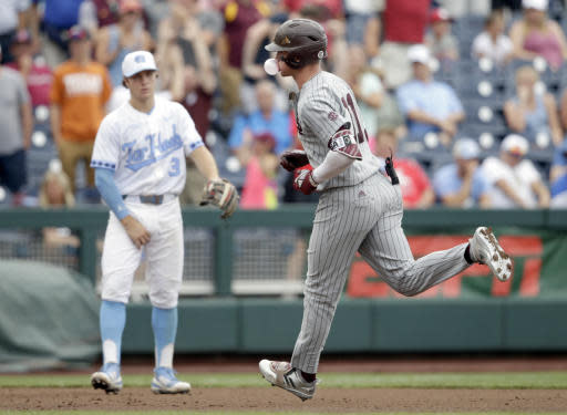 Mississippi State designated hitter Jordan Westburg, (11) chews bubble gum as he rounds the bases past North Carolina third baseman Kyle Datres (3) after hitting a grand slam in the second inning of an NCAA College World Series baseball game against North Carolina in Omaha, Neb., Tuesday, June 19, 2018. (AP Photo/Nati Harnik)