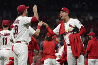 St. Louis Cardinals' Kwang Hyun Kim, right, celebrates with teammate Nolan Arenado (28) after the Cardinals win over the Milwaukee Brewers in a baseball game to clinch a playoff spot Tuesday, Sept. 28, 2021, in St. Louis. (AP Photo/Jeff Roberson)
