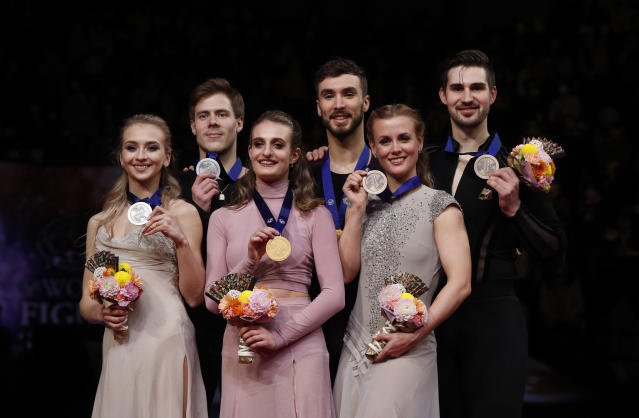 From left to right on podium, Russia's Victoria Sinitsina and Nikita Katsalapov, Gabriella Papadakis and Guillaume Cizeron of France, and Madison Hubbell and Zachary Donohue of the U.S. stand on the podium with their silver, gold and bronze medals respectively for the ice dance free dance during the ISU World Figure Skating Championships at Saitama Super Arena in Saitama, north of Tokyo, Saturday, March 23, 2019. (AP Photo/Andy Wong)