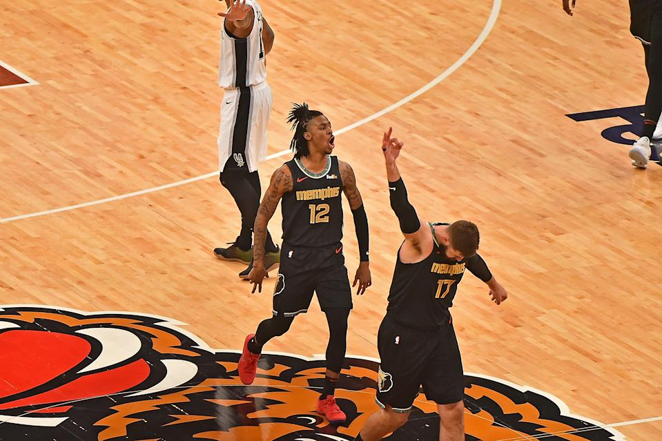Memphis Grizzlies Ja Morant and Jonas Valanciunas celebrate during the first half of their victory on Thursday. (Justin Ford/Getty Images)