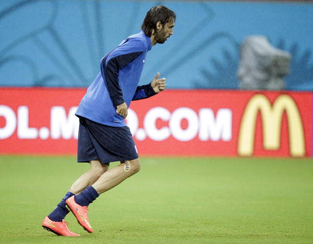 Greece's Giorgos Samaras warms up during a training session of Greece in the Arena Pernambuco stadium, Recife, Brazil, Saturday, June 28, 2014. Greece will play Costa Rica in a World Cup round of 16 soccer match next June 29.(AP Photo/Andrew Medichini)