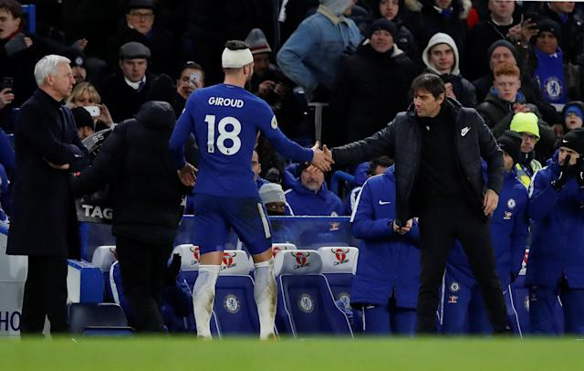 "Soccer Football - Premier League - Chelsea vs West Bromwich Albion - Stamford Bridge, London, Britain - February 12, 2018 Chelsea's Olivier Giroud shakes hands with manager Antonio Conte as he is substituted REUTERS/Eddie Keogh EDITORIAL USE ONLY. No use with unauthorized audio, video, data, fixture lists, club/league logos or ""live"" services. Online in-match use limited to 75 images, no video emulation. No use in betting, games or single club/league/player publications. Please contact your account representative for further details."
