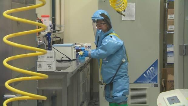Dr. Xiangguo Qiu was escorted out of the National Microbiology Lab in Winnipeg in July 2019. She was then fired last January, but the Public Health Agency of Canada refuses to say why. (CBC - image credit)