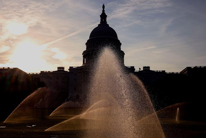 Sprinklers water the West Front of the U.S. Capitol Building on July 26, 2021, in Washington, DC, as the Senate works towards finalizing the bipartisan infrastructure bill.