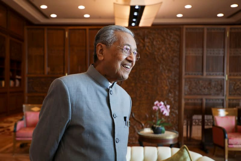 Malaysia's Prime Minister Mahathir Mohamad reacts during an interview with Reuters in Putrajaya