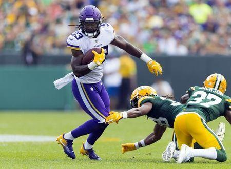 Sep 16, 2018; Green Bay, WI, USA; Minnesota Vikings running back Dalvin Cook (33) rushes with the football during the second quarter against the Green Bay Packers at Lambeau Field. Mandatory Credit: Jeff Hanisch-USA TODAY Sports