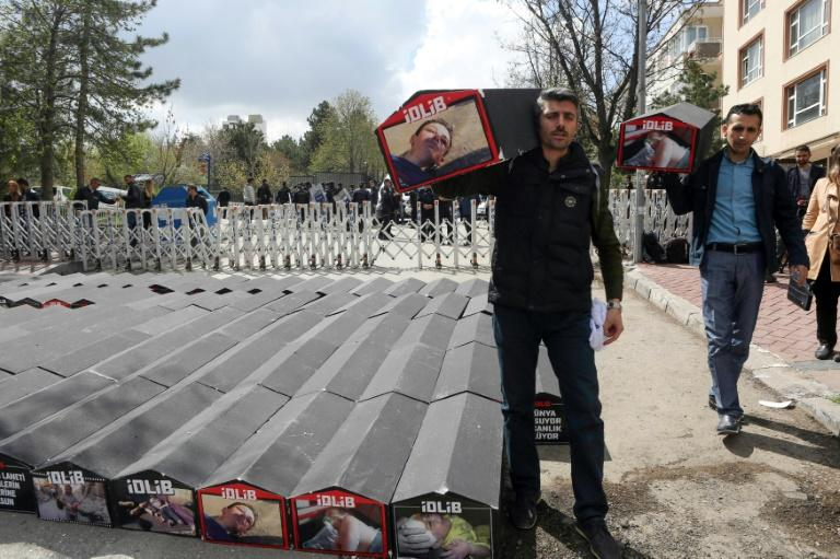 A man carries a symbolic coffin during a protest in Ankara against Russia's alleged role in a chemical attack in Syria