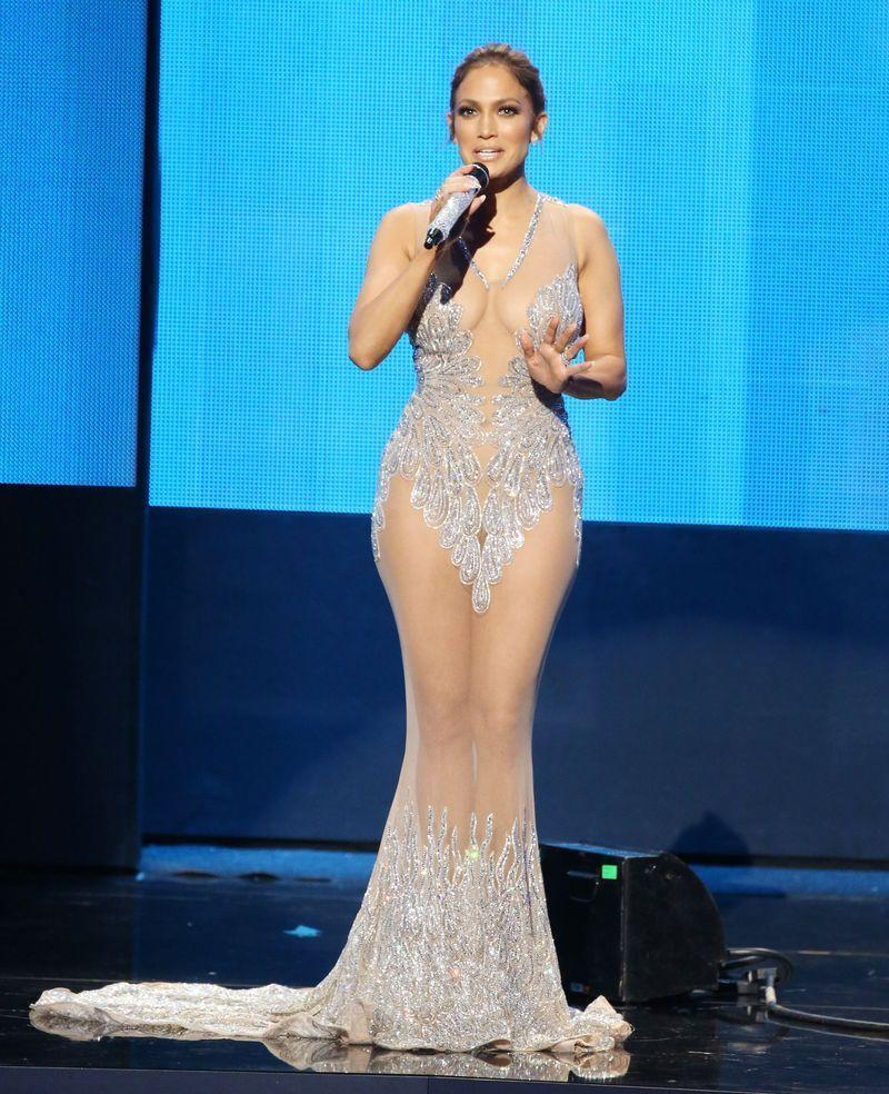 """<p>Jennifer Lopez pushed the naked dress envelope with this perfectly positioned design at the <a href=""""https://www.cosmopolitan.com/uk/beauty-hair/celebrity-hair-makeup/news/g4244/america-music-awards-2015-hair-makeup/"""" rel=""""nofollow noopener"""" target=""""_blank"""" data-ylk=""""slk:2015 American Music Awards"""" class=""""link rapid-noclick-resp"""">2015 American Music Awards</a>.</p>"""
