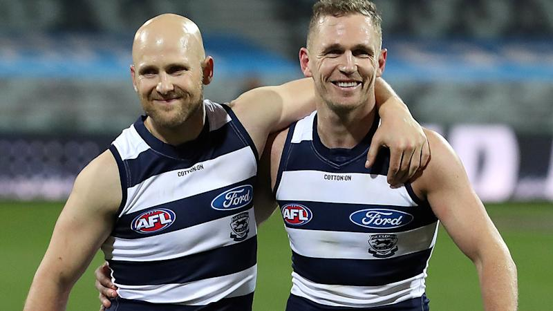 Gary Ablett and Joel Selwood, pictured here leaving the field after Geelong's victory.
