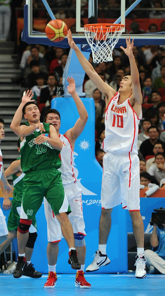 Zhang Zhaoxu of China (R) blocks a pass by Uuganbayar Oyuntsetseg of Mongolia during the men's preliminary round group E basketball match at the Guangzhou International Sport Arena at the 16th Asian Games on November 16, 2010. China won 91:46. AFP PHOTO / Antony DICKSON (Photo credit should read ANTONY DICKSON/AFP/Getty Images)