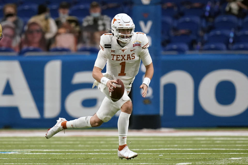 FILE - Texas quarterback Hudson Card (1) is shown during the second half of the Alamo Bowl NCAA college football game against Colorado in San Antonio, in this Tuesday, Dec. 29, 2020, file photo. Casey Thompson's Alamo Bowl performance made him look like an easy pick to be starting quarterback at Texas in 2021. But a coaching change from Tom Herman to Steve Sarkisian and the ripe talent of backup Hudson Card has made Saturday's spring scrimmage, and the months leading into the 2021 season, all about one position and who be the starter against Louisiana on Sept. 4. (AP Photo/Eric Gay, File)