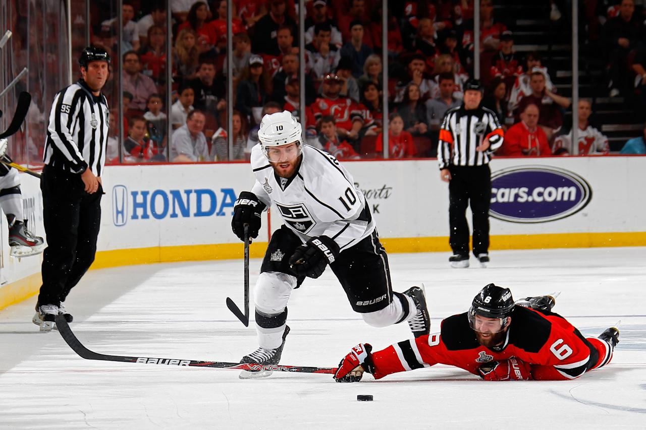 NEWARK, NJ - JUNE 09: Mike Richards #10 of the Los Angeles Kings goes for a loose puck as Andy Greene #6 of the New Jersey Devils hits the ice during Game Five of the 2012 NHL Stanley Cup Final at the Prudential Center on June 9, 2012 in Newark, New Jersey.  (Photo by Bruce Bennett/Getty Images)
