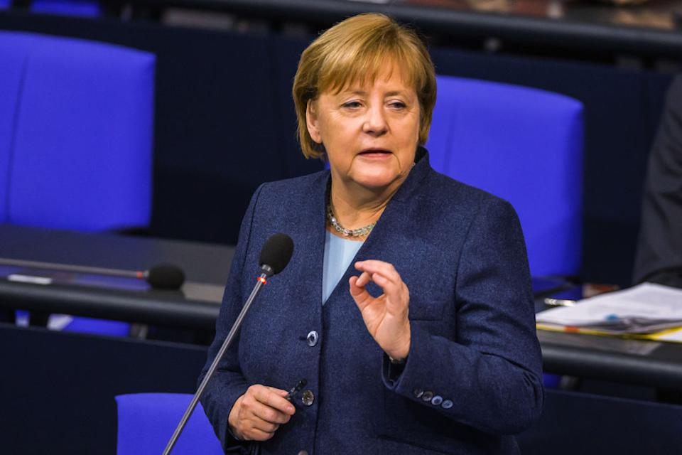 Angela Merkel, Germany's chancellor, gestures while speaking in the Bundestag in Berlin, Germany, on Wednesday, Dec. 16, 2020. German ChancellorAngela Merkelhinted that a hard shutdown that takes effect Wednesday will remain in force beyond January as the country's daily death toll jumped to a record 910 people. Photographer: Rolf Schulten/Bloomberg