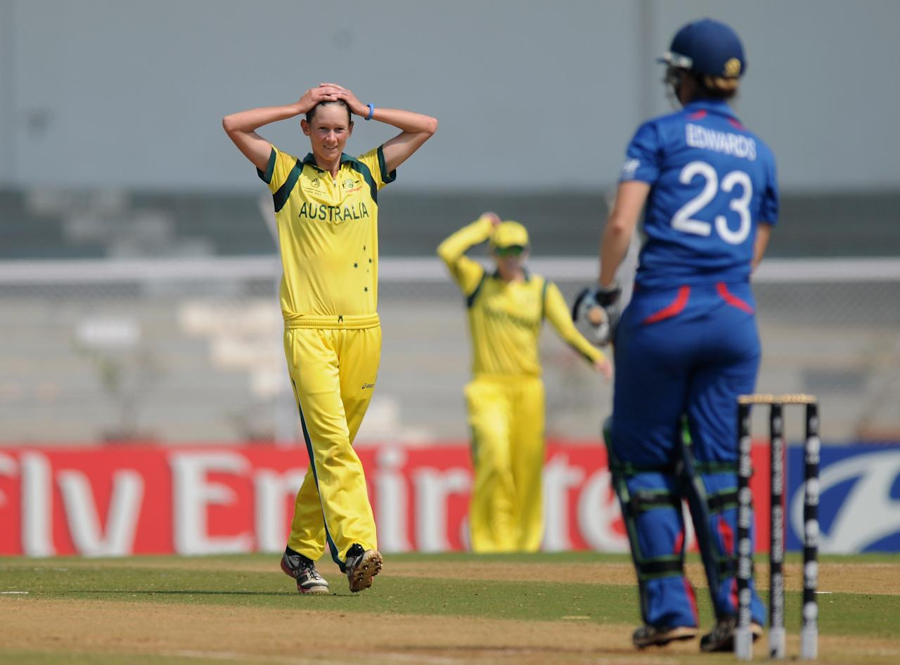 MUMBAI, INDIA - FEBRUARY 08:   Julie Hunter of Australia reacts as she bowls buring the super six match  between England and Australia held at the CCI (Cricket Club of India)  on February 8, 2013 in Mumbai, India.  (Photo by Pal Pillai/Getty Images)