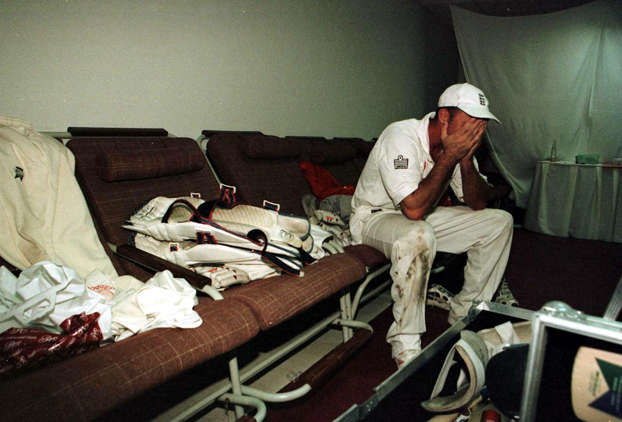 11 Dec 2000:  An emotionally drained Nasser Hussain reflects on an away series win in the dressing room during the 3rd Pakistan v England Test match at the National Stadium, Karachi, Pakistan. Mandatory Credit: Laurence Griffiths/ALLSPORT