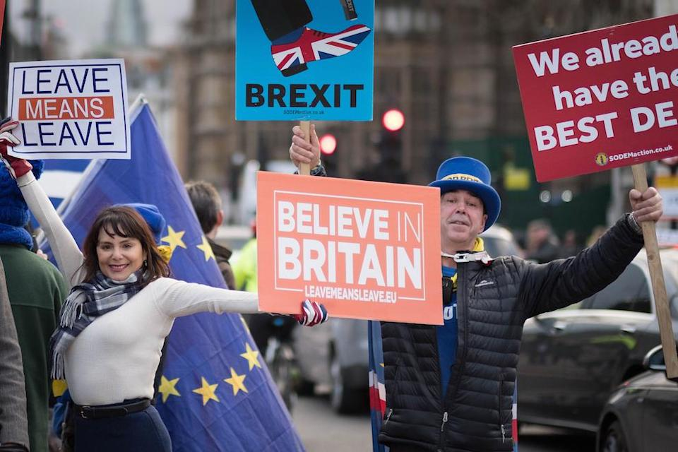 Pro and anti-Brexit demonstrators outside the Houses of Parliament in London before Tuesday's Commons vote (Picture: PA)
