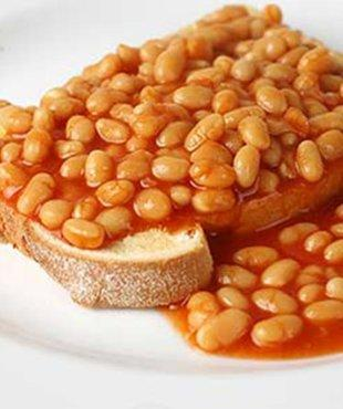 Consider brown bread, if you want to have a healthy breakfast option. Toast and smear some margarine or butter on it. Meanwhile heat the canned beans and add dry chili flakes and a little salt to taste. Have it for breakfast and you will love it.