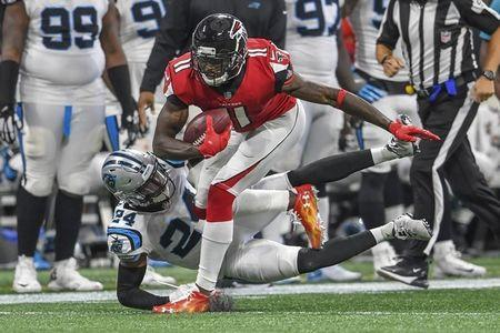 Sep 16, 2018; Atlanta, GA, USA; Atlanta Falcons wide receiver Julio Jones (11) tries to break a tackle by Carolina Panthers cornerback James Bradberry (24) during the second half at Mercedes-Benz Stadium. Mandatory Credit: Dale Zanine-USA TODAY Sports