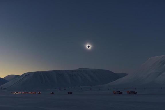The eclipse cuts a starkly beautiful silhouette against of the Arctic landscape of Svalbard.