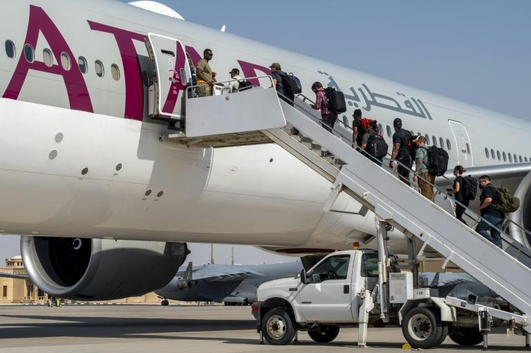 US embassy personnel evacuated from Afghanistan are flown on from Qatar to Kuwait on board a civilian aircraft