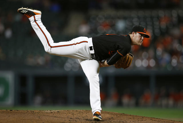 Baltimore Orioles starting pitcher David Hess follows through to the Houston Astros in the second inning of a baseball game, Friday, Sept. 28, 2018, in Baltimore. (AP Photo/Patrick Semansky)
