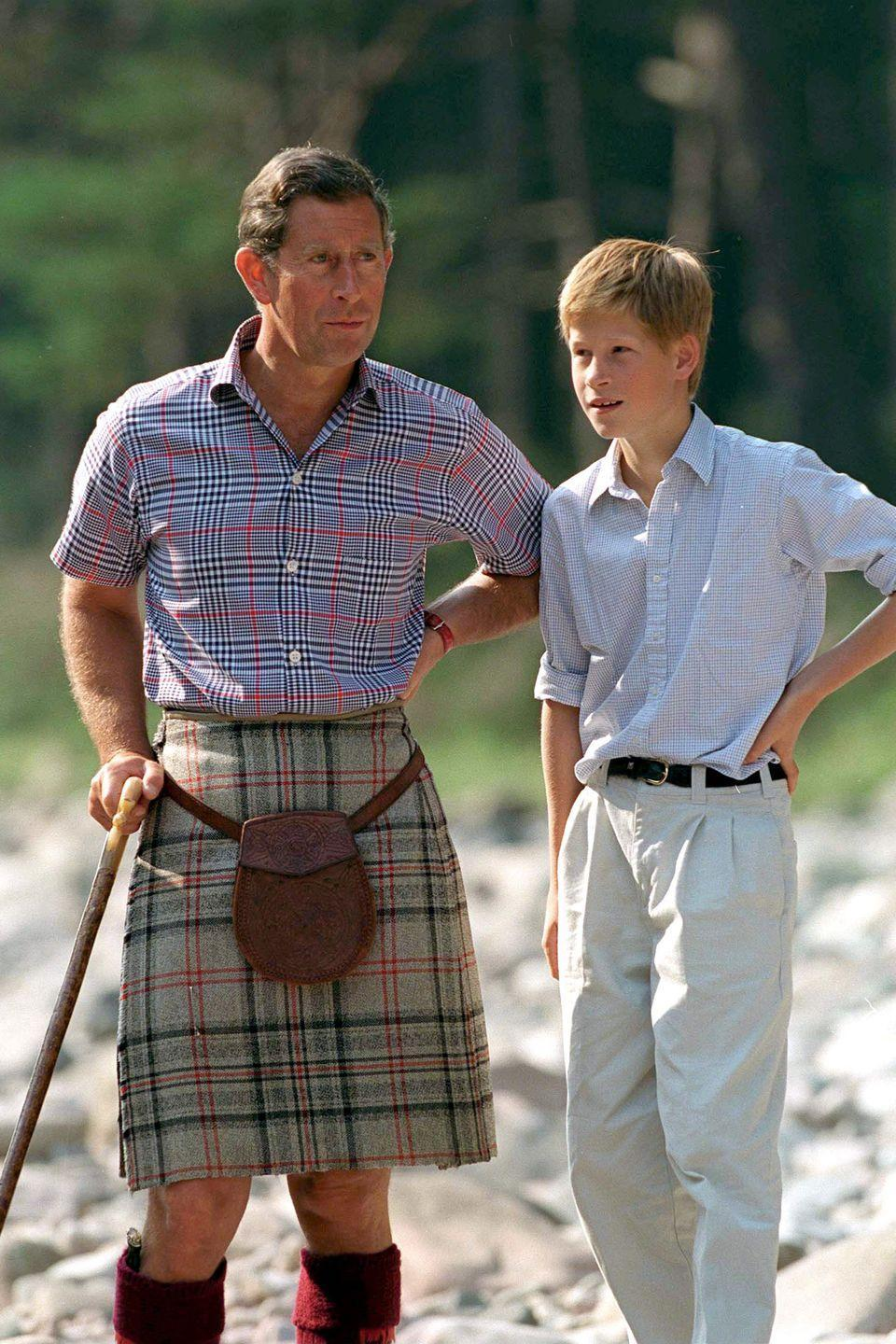 <p>Harry talks with Prince Charles at Balmoral Castle Estate.</p>